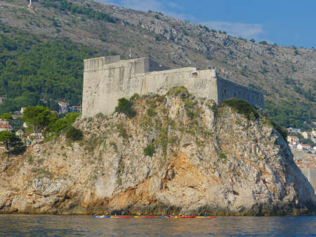 Dubrovnik Croatia - August 6 2018: Ancient Fort Lovrijenek outside Dubrovnik old town walled city and new town with modern town architecture