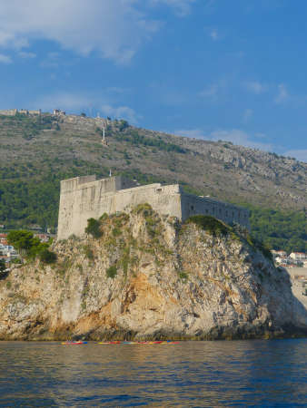 Dubrovnik Croatia - August 6 2018: Ancient Fort Lovrijenek outside Dubrovnik old town walled city and new town with modern town architecture Imagens - 115968645