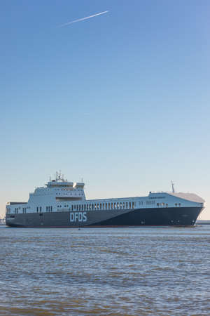 Hoek van Holland, the Netherlands - January 20 2019: car passenger ferry ship DFDS Gardenia seaways sailing out of port Rotterdam past Hoek van Holland and Maasvlakte harbour Imagens - 115968690