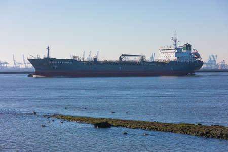 Hoek van Holland, the Netherlands - January 20 2019: petro chemical gas tanker vessel sailing past Hoek van Holland and Maasvlakte harbour towards port Rotterdam