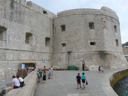 Dubrovnik, Croatia - August 3 2018: Dubrovnik old town harbour view of Fort st Ivana with tourists in foreground