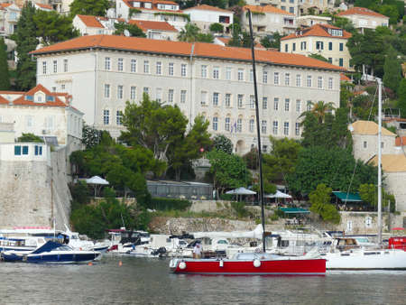 Dubrovnik, Croatia - August 3 2018: Dubrovnik harbour view of historic building with boats in forground