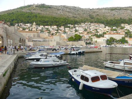 Dubrovnik, Croatia - August 3 2018: Dubrovnik old town harbour view of new town in background with boats in forground Editorial