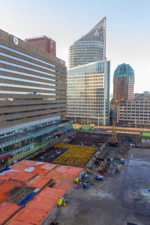 The Hague city centre - February 3 2019: renovation work at The Hague central station wsurrounded by modern tall buildings