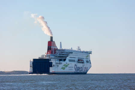 Hoek van Holland, the Netherlands - January 20 2019: car passenger ferry ship Stena Line sailing out of port Rotterdam past Hoek van Holland with smoke and steam coming out of funnel Editorial