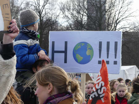 Malieveld, The Hague, the Netherlands - February 7 2019: school children, families and youth at climate change policy protest in The Hague closeup