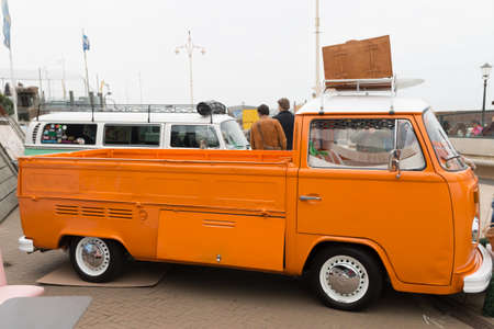 Scheveningen, The Hague, the Netherlands - May 26 2019: 1960s style VW Transporter  Kombi utility vehichle parked at Scheveningen beach