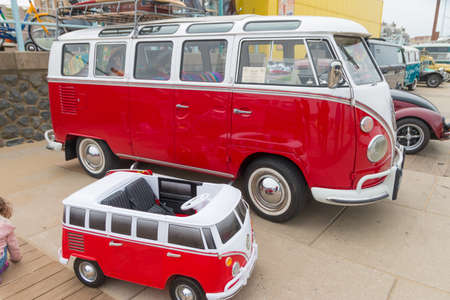 Scheveningen, The Hague, the Netherlands - 1960s classic Kombi and miniature combi parked at Scheveningen beach