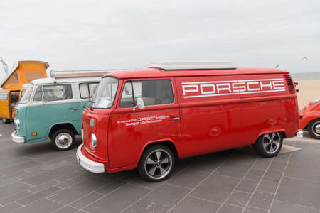 Scheveningen, The Hague, the Netherlands - May 26 2019: 1960s  VW combi with porsche logo on the side parked at Scheveningen beach during aircooled classic vw motor show Editorial