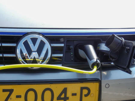 The Hague, the Netherlands - April 214 2019: VW electric hybric car charging at plug in station
