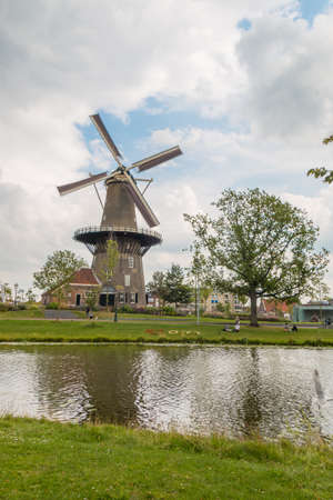 Leiden, the Netherlands - July 19 2019 dutch windmill de Valk on Leiden Canal Editorial