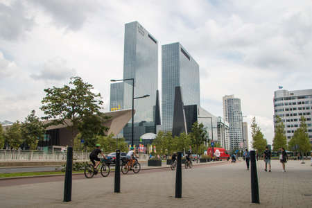 Rotterdam, the Netherlands - July 19 2019: modern architecture of Rotterdam office buildings, modern city high rise, tall towers and roof central station in forground
