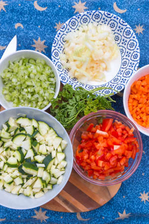 freshly chopped vegetables ready for cooking  on flat lay, top view with copy space Imagens