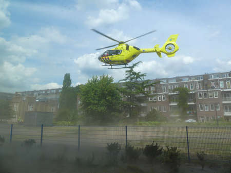 Rietland park, Amsterdam, the Netherlands -July 18 2018: emergency medical trauma helicopter lifting off in Amsterdam to attend victims of traffic accident