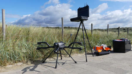 Monster, south holland, the Netherlands - September 19 2019: large industrial commercial drone with monitor on stand in the countryside