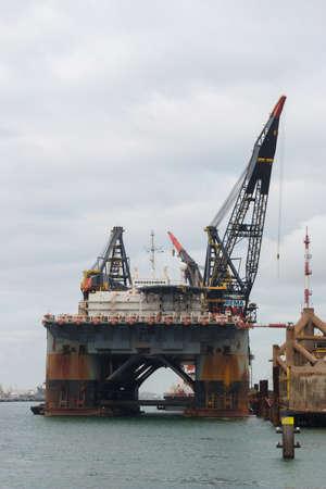 Rozenburg, the Netherlands - December 7 2019: deep water heavy lift barge near Rotterdam harbour