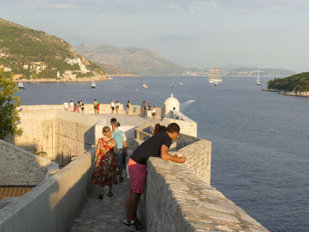 old town Dubrovnik, Croatia - August 4 2018: tourists walking along the wall of Dubrovnik old town