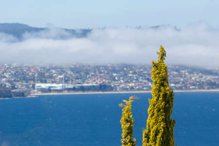 Hobart, Tasmania, Australia - December 24 2016: Hobart city and derwent river viewed from suburb of sandy bay with sea mist rolling over eastern shore 版權商用圖片