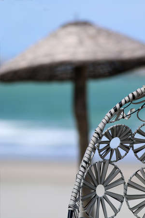 tropical beach resort concept umbrella with ocean in background with blue sky