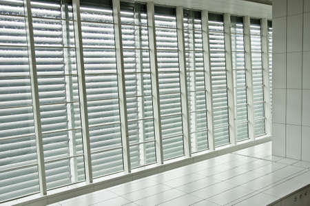pathways: Contrast window panels with blinds beside tiled pathway Editorial