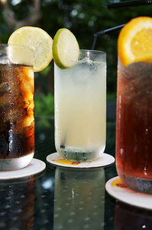 Three ice cold drinks, Cola, Lime and Cranberry Juice