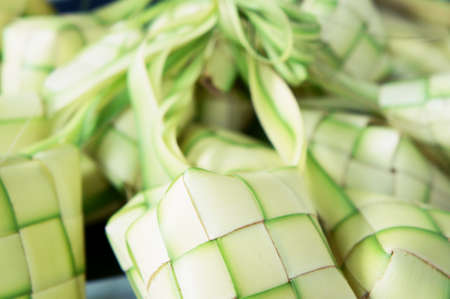 compressed rice: Ketupat: South East Asian rice cakes bundle, often prepared for festivities and celebratory occasions.                    Stock Photo