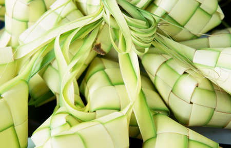 Ketupat: South East Asian rice cakes bundle, often prepared for festivities and celebratory occasions.                    Stock Photo