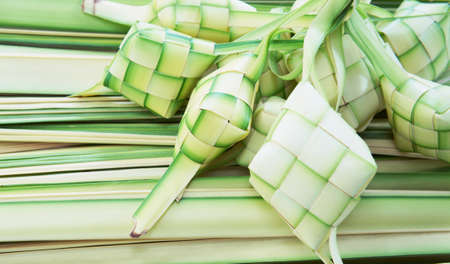 starchy food: Ketupat: South East Asian rice cakes bundle, often prepared for festivities and celebratory occasions.