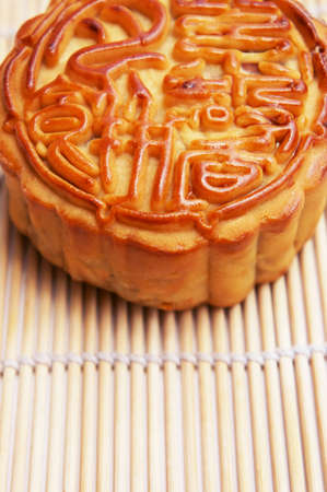 Close up of a Tradditional Mooncake supported by a mat                 photo