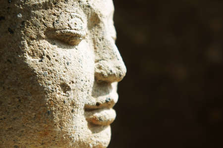 Side profile close up of Buddha face             Stock Photo