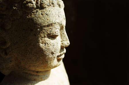Side profile of a stone buddha                  Stock Photo - 10883940