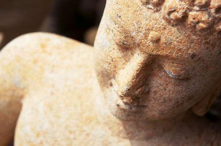 stone buddha: Red stone buddha, thailand                       Stock Photo