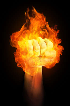 override: A strong holding fist is on fire Stock Photo