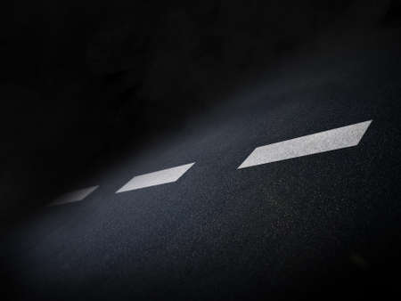 leading light: A light spot on highway leading toward darkness Stock Photo