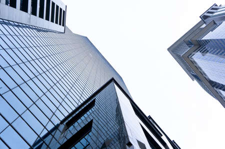 commercial activity: Low angle shot of two glass towers