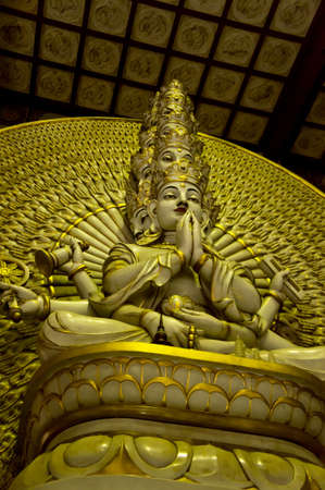 A golden statue of Buddha with thousand hands Stock Photo - 11117302