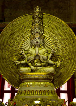 thousand: A golden statue of Buddha with thousand hands