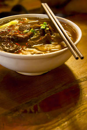 thai noodle soup: A bowl of chinese style beef noodle soup.