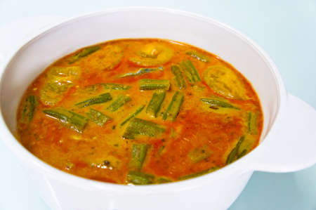 Curry Vegetables served in a white bowl.
