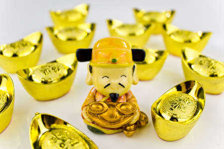 Fortune God carrying ancient gold ingot wishing prosperity with white background photo
