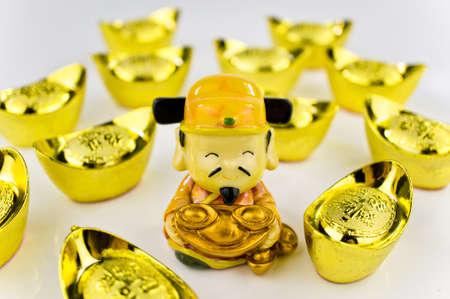 gold ingot: Fortune God carrying ancient gold ingot wishing prosperity with white background