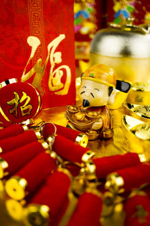Fortune God carrying ancient gold coin wishing prosperity Stock Photo