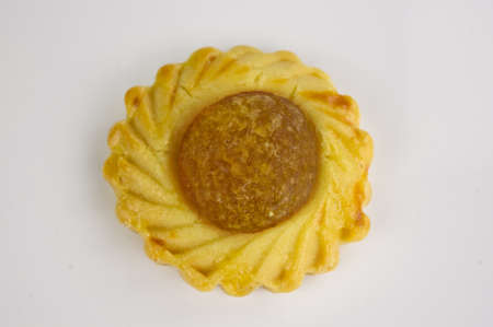 Top view of one Chinese festive Pineapple biscuit on white background