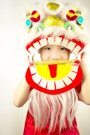 lion dance: Boy New Year celebration with Lion Dance Stock Photo
