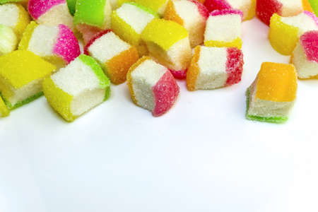 chewy: Top pile up with colorful soft chewy sugar coated sweet candies on white