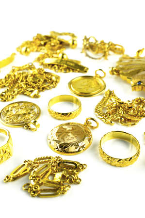 Vertical shot of Gold in varies jewelry form on white isolated background Stock Photo
