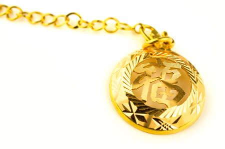 dowry: Close up of a Heirloom gold jewelry with chinese character  Blessing  writing on it  Stock Photo