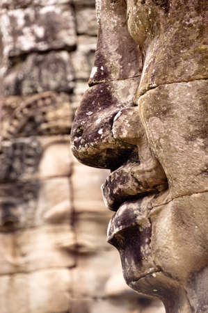 khmer: Close up side view of Bayon Stone faces.