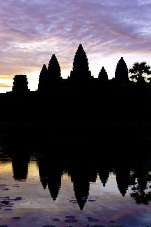 angkor wat: Angkor Wat silhouette during sunrise with water reflection
