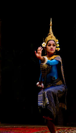 SIEM REAP, CAMBODIA- May 2012  A traditional Khmer Cambodian female dancer in Apsara dance pose against black